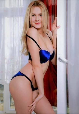 Escort girl living in Bursa Lana is close to the window, half-opening herself the same as she half-opens this white window