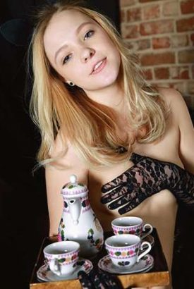 Ukrayna escort fiyatları girl offers a tray of tea and a pot covering her naked breast with a hand